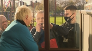 Jean Culleton gets a visit at her window from Peter