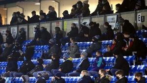 Socially distanced fans in the stands during the Sky Bet Championship match at Adams Park, Wycombe