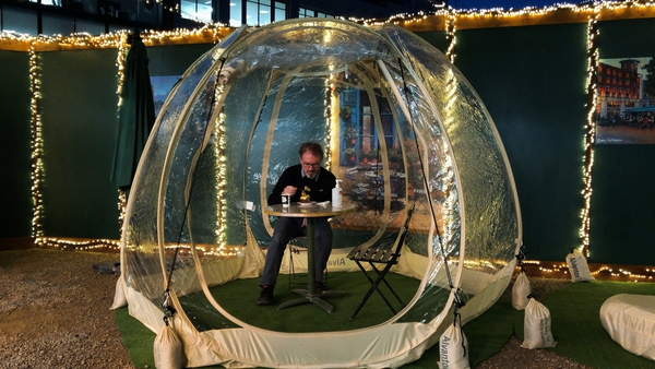 Tram Café co-owner Dave Fitzpatrick tests out a 'dining bubble'