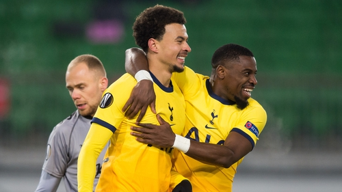 Dele Alli celebrates his penalty with Serge Aurier