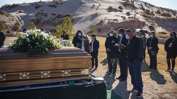 Family and friends attend the funeral of a Covid-19 victim in New Mexico, USA