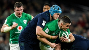 Jonathan Sexton of Ireland is tackled by Scott Cummings in February