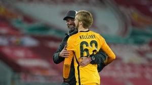 Jurgen Klopp (L) embraces Caoimhin Kelleher at the final whistle against Ajax