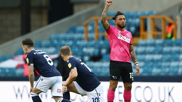 Colin Kazim-Richards of Derby County raises his right fist before the clash at The Den
