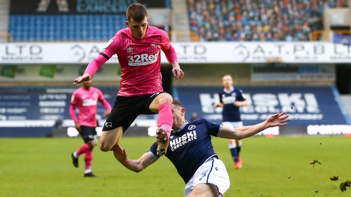 Murray Wallace of Millwall battling for possession with Jason Knight of Derby County and Ireland (l)