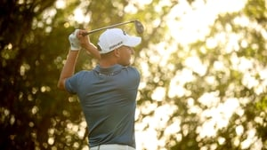 Emiliano Grillo of Argentina plays his shot from the 17th tee