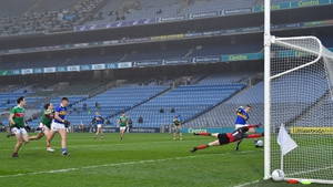 David Clarke makes a save from Michael Quinlivan