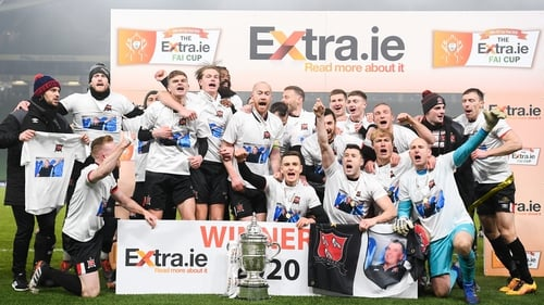 Dundalk players, wearing T-shorts in tribute to their late groundsman Harry Taaffe, start the celebrations