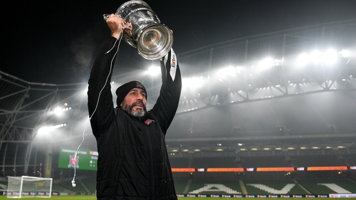 Filippo Giovagnoli hoists the FAI Cup following his side's 4-2 extra-time victory over Shamrock Rovers