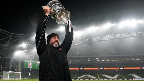 Filippo Giovagnoli hoisting the FAI Cup at an empty Aviva Stadium