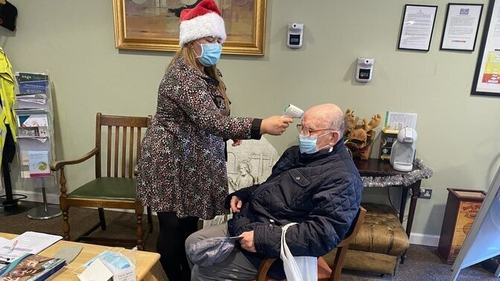 Roy Brown gets a temperature check before visiting his wife Ann at St Joseph's Nursing Home Shankill in Dublin