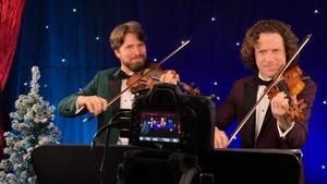 Vladimir Jablokov (R) and his brother Anton perform for Maura Murray