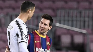 Cristiano Ronaldo greets Lionel Messi Tuesday night's clash between Barcelona and Juventus