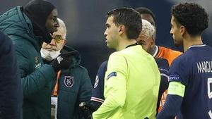 Basaksehir's Demba Ba (L) speaks to referee Ovidiu Hategan on Tuesday night