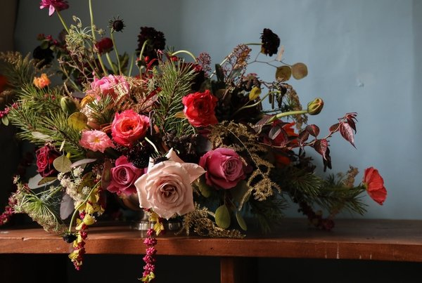 There's nothing that creates a festive table better than a glorious flower and foliage decoration.