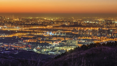 Buildings and lights seen from Xishan mountain in Beijing at dawn on 8 December