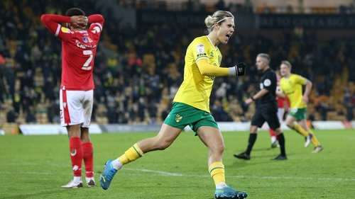 Todd Cantwell celebrates Norwich City's second goal scored by Emi Buendia