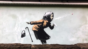 The image is on the exterior wall of a house on Vale Street in Bristol, the steepest street in England