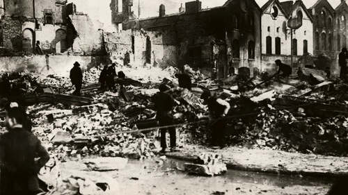 People cleaning up the destruction from the burning of Cork by British forces in December 1920. Photo:  George Rinhart/Corbis via Getty Images