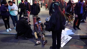 A protester has his leg bandaged after a car struck multiple Black Lives Matter protesters