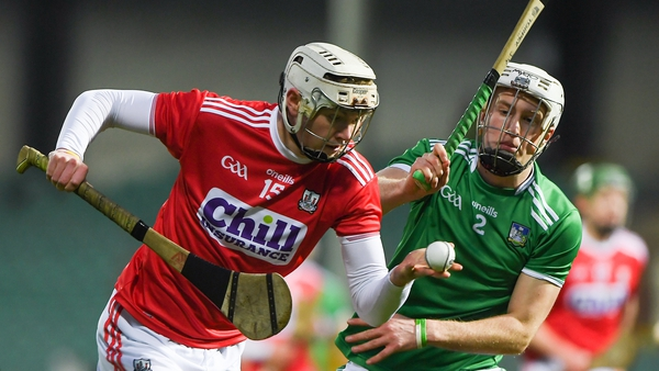 Shane Barrett of Cork tries to evade Limerick's Jimmy Quilty at the Gaelic Grounds.