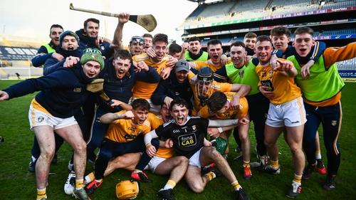 Antrim players celebrate their Joe McDonagh success