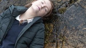Áine gets drunk alone at the beach