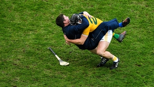 Donal Nugent and Darren Gleeson celebrate Antrim's win in rambunctious style