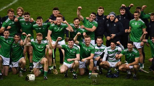 Limerick players celebrate with the Liam MacCarthy Cup