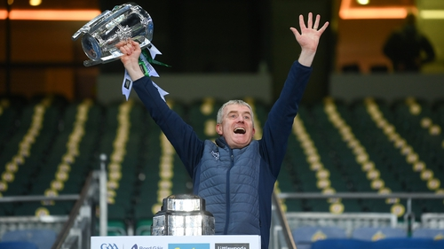 Limerick manager John Kiely lifts the Liam MacCarthy cup