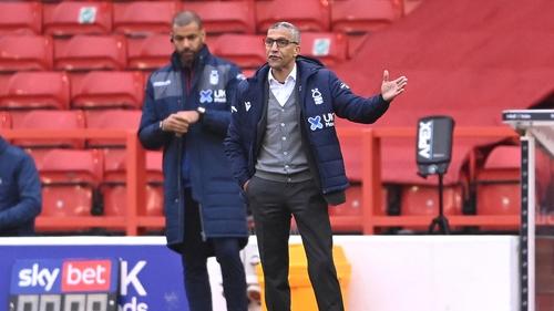 Chris Hughton and Forest first team coach and fellow former Ireland international Steven Reid (l)