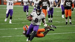 Baltimore Ravens quarterback Lamar Jackson runs in a touchdown during the second quarter