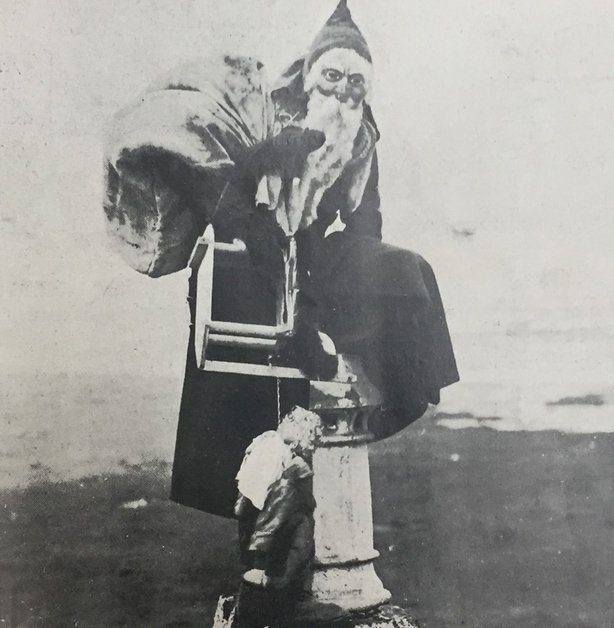 A photo, according to Irish Life in 1920, of the real Santa caught in the act of climbing down a chimney Photo: Irish Life, 26 November 1920