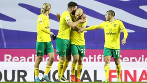 Teemu Pukki celebrates with his fellow Canaries