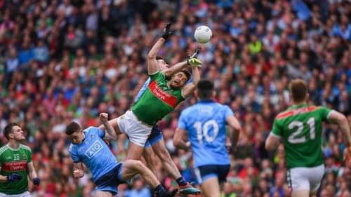 Aidan O'Shea of Mayo and Michael Darragh Macauley of Dublin contesting a high ball last year