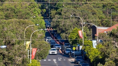 Cars are seen lining up at a Covid-19 pop-up testing drive-through station in Avalon, Sydney