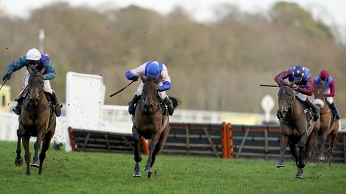 Aidan Coleman riding Paisley Park (R, spotted cap) clear the last to win the Ascot feature