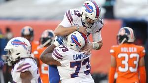 Josh Allen #17 and Dion Dawkins #73 of the Buffalo Bills celebrate a touchdown