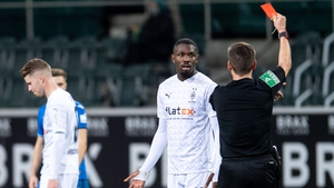 Referee Frank Willenborg shows Monchengladbach's French forward Marcus Thuram the red card