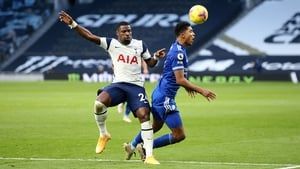 Serge Aurier bundles over Wesley Fofana to give Leicester a penalty.