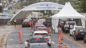 Cars wait in line at a Bondi Beach Covid-19 drive-through testing clinic
