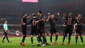 Manchester City put four past Arsenal to progress