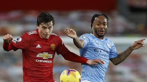 Victor Lindelof (left) and Raheem Sterling battle for possession earlier this month