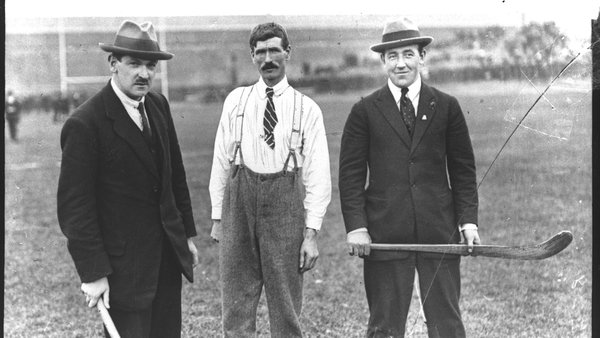 From left to right; Michael Collins, Mr Dunphy and Harry Boland, at a hurling match at Croke Park, Dublin 1921. Photo: RTE Photographic Archive