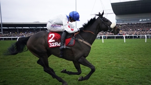Harry Cobden and Clan Des Obeaux win the 2018 King George in front of packed stands at Kempton