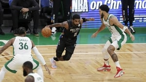 Kyrie Irving of the Brooklyn Nets drives to the basket during the first quarter of the game against the Boston Celtics at TD Garden