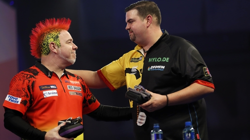 Peter Wright congratulates surprise winner Gabriel Clemens at the Ally Pally