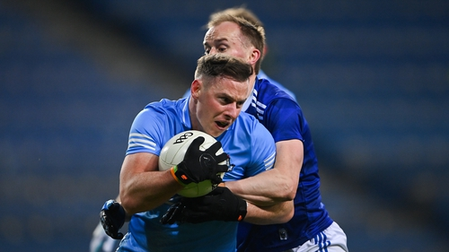 McMahon is tackled by Martin Reilly of Cavan during the All-Ireland semi-final in December