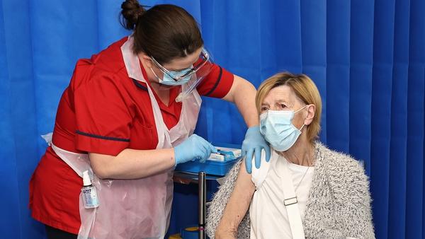 Annie Lynch getting the vaccine in St James's Hospital, Dublin from Deborah Cross