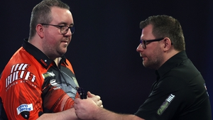 Stephen Bunting (left) came from two sets down to beat James Wade